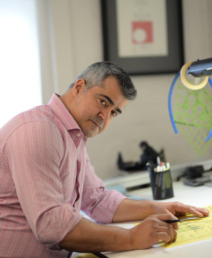 Photo of Michael Ellis at his desk
