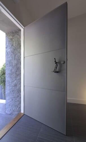 front door with sculpted handle